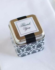 Michaels.com Wedding Department: Classic Silver Tin Favors Give silver tins a classic makeover with sophisticated paper like this pretty damask. Add the finishing touches with coordinating satin ribbon found by the yard and a Gartner Studios Thank You Seal. Courtesy of Gartner Studios®