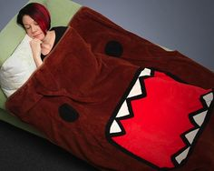 Cozy up with the lovable monster Domo, with this Domo Face Micro Raschel Fleece Blanket!