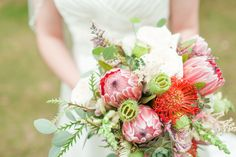 Loved it! Pinned it! A Blooming Envy Design! Photo by Ashlea Snell Photography. Bouquet designed with Pin Cushion Protea, Pink Ice Protea, Blush Garden Roses, Blush Snapdragons, Eucalyptus and Grevillea.