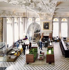 England,Ian Schrager,hotel,luxury hotel,boutique hotel,Berners Street,New Edition,Georgian architecture,Fitzrovia,Marriott International,interior,lobby,people,sphere,Ingo Maurer,Belle Epoque,lobby,balcony,bar,bar stool,bottle,countertop,people,man,castiron,moulding,stucco,railing
