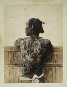 Vintage photo of a Japanese wearing a samurai tattoo - Circa late 1800. I love old photographs. They capture so much character and mystery at the same time. A photo by Italian-British photojournalist Felix Beato. #TattooModels #tattoo