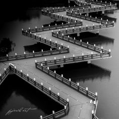 """Bridge in Dragon and Tiger Tower Temple at Lotus Pond in Kaohsiung, Taiwan  (Product of photoshop by altering it to appear as it """"zig zags"""".)"""