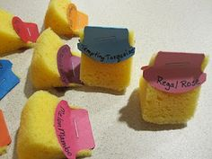 great tip for your stamping sponges. This has been posted on several blogs over the last few months. I have no idea who first came up with this great idea but I love it. I like being able to keep a sponge to use for just one color. That way I don't end up with a diffent color than I expected.    You start by cutting a sponge into eight pieces.        Then punch card stock using the Round Tab punch.        Write the color name on both sides of the punched card stock.        Fold the punched…