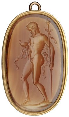 his large intaglio gem shows a satyr, a follower of the wine god Bacchus. His tail indicates his half-animal nature and behaviour. He peers searchingly into a drinking bowl to see whether there is any wine left. Leaning on his staff, he tries to keep his balance.  This gem was carved from red carnelian and dates from the early Roman Empire (1st or 2nd century AD).