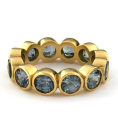 18K GOLD JUMP RING WITH BLUE GREEN SAPPHIRES: Bold and beautiful, this 18k yellow gold band is circled with large blue-green sapphires bezel set in gold.  This can be created in white or rose gold, or in platinum with other gems of your choice.