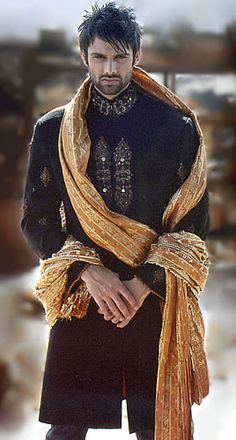 Men's wedding sherwani in black and gold