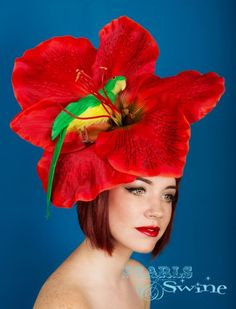 Zanzibar -Giant Red Flower Hat with Green Parrot Flamboyantly tropical huge red flower headpiece, with red glitter highlights on the petals... that is guaranteed to turn heads, perfect for Ladies Day at Ascot! Set on a fascinator base with green leaves, attaches with a comb, this is large but not very heavy, if needed you can secure with a few extra bobby pins. http://www.pearlsandswine.com