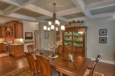 Formal dining room with coffered ceiling.
