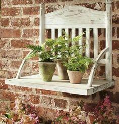 Chair top repurposed as shelf.