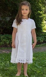 Look how sweet she looks in this gorgeous cotton white dress!