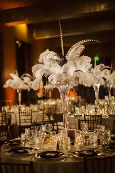 Feather centerpieces in tall crystal vases