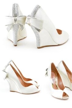 A pair of gorgeous white wedges for a beautiful blushing bride. Love the bows and the bling these are gonna be mine