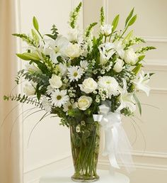 All White Large Sympathy Vase-Send your most sincere condolences and offer comfort and beauty in times of sorrow with our elegant all-white sympathy arrangement. Features the freshest white roses, hybrid lilies, cremones and more. Accented with myrtle, spiral eucalyptus and more. #CentralSquareFlorist #CambridgeFlowers #SympathyFlowers