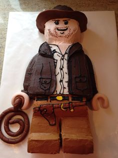 Lego Indiana Jones cake for my nephew's 8th birthday. Used buttercream for most of it because he doesn't like fondant. Used @2juliey pin for reference. :-)
