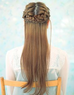 Two french braids into crown (back).  It's like the Katniss Reaping Braids, but only half the hair.