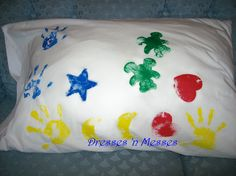 buy cheap white pillowcases and shaped sponges for the kids to decorate their pillowcase. You may also do hand prints.