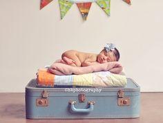 Suitcase, blankets, banner
