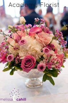 Garden-inspired centrepiece in pinks and purples by @Academy Florist