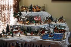 our snowvillage love love love it! My hubby made my display table
