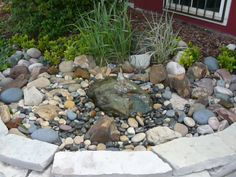 We drill holes in boulders for water features.