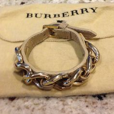 Burberry Leather strap bracelet Burberry leather strap bracelet with gold chain detail. Item includes dustbag. Burberry Jewelry Bracelets