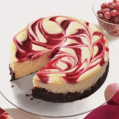 Cranberry Swirl Cheesecake-- My Favorite Cheesecake Recipe. Always turns out awesome and you can change up the flavor, especially since Chambord isn't kosher.
