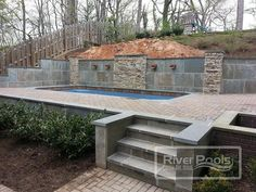 Pool Retaining Walls for Sloped Yards: Cost, Materials, and More landscaping retaining wall Pool Retaining Walls for Sloped Yards: Cost, Materials, and Sloped Backyard Landscaping, Sloped Yard, Backyard Pool Designs, Small Backyard Pools, Swimming Pools Backyard, Pool Spa, Backyard Patio, Patio Design, Landscaping Ideas