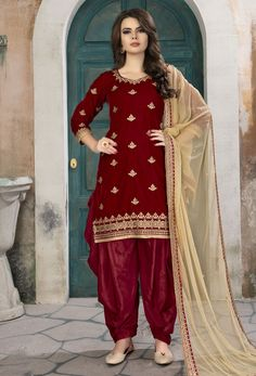 Unique beauty comes out of your dressing trend with this red velvet Punjabi Suit. The beautiful embroidered is a intensive characteristic of this attire. Comes with matching bottom and dupatta. Salwar Kameez Online Shopping, Salwar Suits Online, Punjabi Salwar Suits, Punjabi Dress, Patiala Suit Designs, Embroidered Lace Fabric, Suit Fabric, Suits For Sale, Suit Fashion