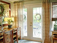 No-sew custom drapes made out of drop cloths embellished with handwritten script.  Make pencil lines first to keep the typography straight - write a poem or song lyrics to personalize.