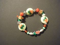 Another Christmas stretchy bracelet made with lampwork beads and sterling silver spacers