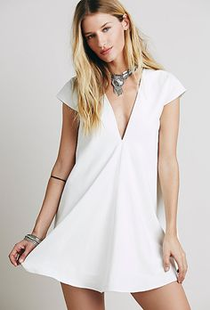 """Brides.com: . """"Dusk till Dawn"""" shift dress, $148, Asilio available at Free People"""