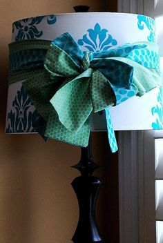 Stenciled Damask Lampshade tutorial bows around lamps! genius to these hideous things!!
