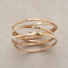 "quintet ring  Five strands of hand hammered 14kt goldfill encircle your finger with infinite style. Each ring is one of a kind. Made in the USA. Whole sizes 5 to 9. 1/4"" W.  $145.00 From Sundance"