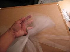 "How to Make a Tulle Bow; See pictures of wedding decorations - pews, tables, bouquets, wreaths & more. Easy ""how to"" instructions."