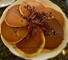 Richard Walker Pancake House in San Diego, CA. Buttermilk pecan pancakes. With warm maple syrup.