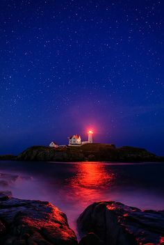 ~~Night at Nubble Lighthouse | red fresnet reflects off the water and rocks under the stars, Cape Neddick, Maine by Mike Blanchette~~
