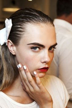 White nails; red lips.
