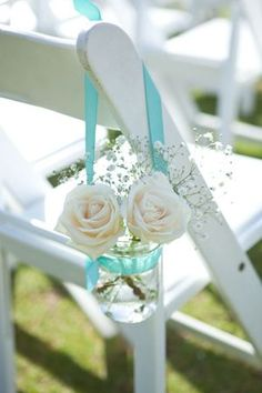 roses in mason jars with aqua ribbon wedding chair decoration ideas for beach weddings
