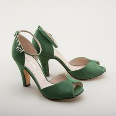 The Lola 1840s Ankle Straps in green are sophisticated, sexy, and perfectly 1940s, featuring beautiful, very vintage green color microsuede, a flattering peep toe, 3.625