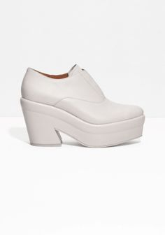 Almond toes Leather lining Cushioned leather insole Leather platform with rubber outsole