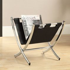 This vinyl magazine features a sturdy chrome frame with a brilliant black vinyl holding area with a leather look. The rack's ample storage area holds plenty of magazines and remote controls.