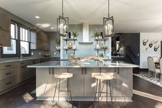 Masters of Flip luxe lodge kitchen island with two stool and modern over-counter light fixtures Masters Of Flip, Home Decor Kitchen, Kitchen Living, Rustic Kitchen Cabinets, Kitchen Island, Kitchen Lighting Fixtures, Light Fixtures, House Flippers, Modern Lodge