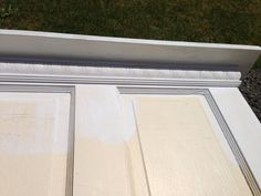 Caulk all open gaps between the door, detail trim and 1x4 and let dry thoroughly. Then prime all exposed wood and caulked areas..