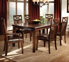 The rich finish on these dining room armchairs give the set a casual, yet versatile feel.
