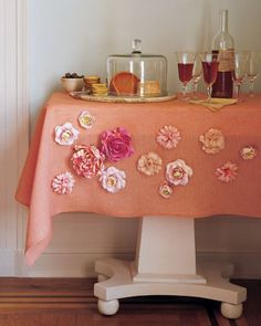 """Magnetic Flowers  Put a little spring into your solid-toned tablecloths by embellishing them with a bunch of magnet-fitted flowers. Unlike sewn-on accents, the blooms can be changed for each season. And you don't need to limit yourself to table settings: This """"arrangement"""" -- including roses, ranunculus, and mums -- would blossom just as brightly on a cafe curtain in the kitchen or even on a living room lampshade."""