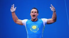 Ilya Ilyin of Kazakhstan celebrates setting a new world record and winning the gold medal in the Men's 94kg Weightlifting final on Day 8 of the London 2012 Olympic Games at ExCeL.