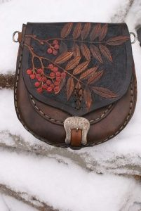 warm brown sporran with hand carved rowan leaves and Celtic knotwork gusset.