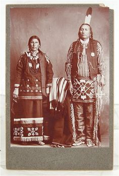 "Rare, original, ca1900, Cabinet Card Photograph of Ponca Indian Couple in traditional dress - the Brave named ""The Warrior"" and wearing an Indian Police Badge."