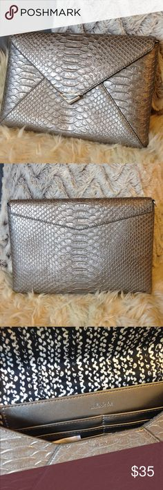"""Stella & Dot NWOT Pewter Envelope Clutch New without tags chic clutch. Perfect for a night out. Measures 11""""x7.5"""". Still has plastic protector on silver chevron detail(pic #4). Six credit card slots. Silver rings on each interior side to add a chain, hang keys or to accessorize with a key chain. Hidden magnetic closure. Stella & Dot Bags Clutches & Wristlets"""