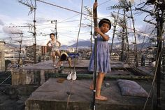 Children playing on the rooftop in Kowloon Walled City, Hong Kong, China, 1989, photography by Greg Girard.